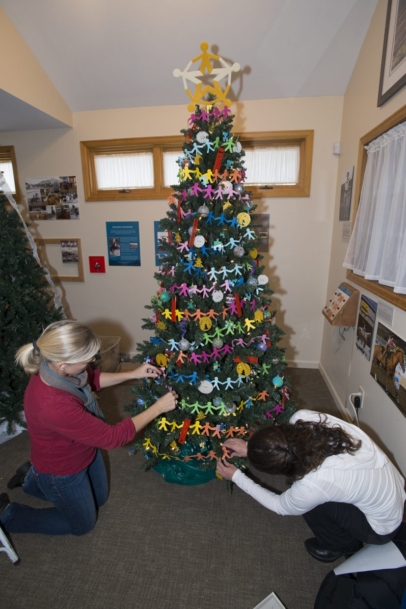 """""""Here's a photo of Michelle McNamara and Monica Niedermeier decorating The Challenge Fund tree at the Tread of Pioneers' annual Festival of Trees. Some of our students were able to get hands-on experience with innovative technology - they designed and printed on a 3-D printer many of the ornaments on the tree."""" Submitted by Chris Johnson."""