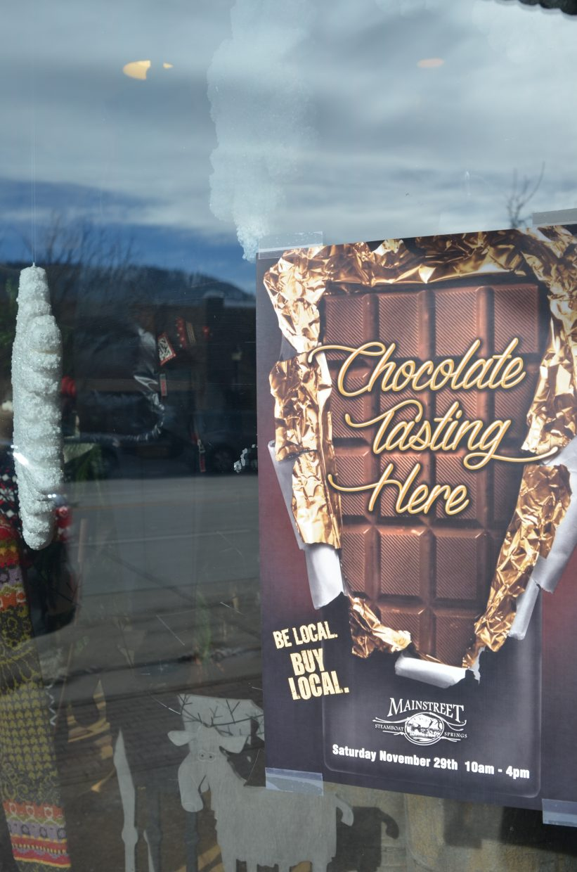 To support Small Business Saturday in Steamboat Springs, locals and visitors can take part in the Chocolate Tasting event throughout downtown. Participating businesses will have one of these posters in the window.