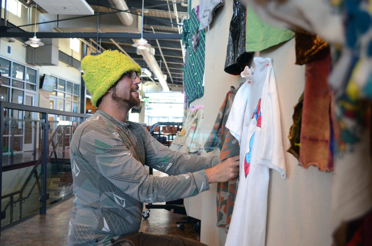 Colorado Mountain College student Dave Demalteris, 34, pins up his final product as part of his art and sustainability class. A fashion exhibit displaying the students' work will be on display through Dec. 2 at CMC.