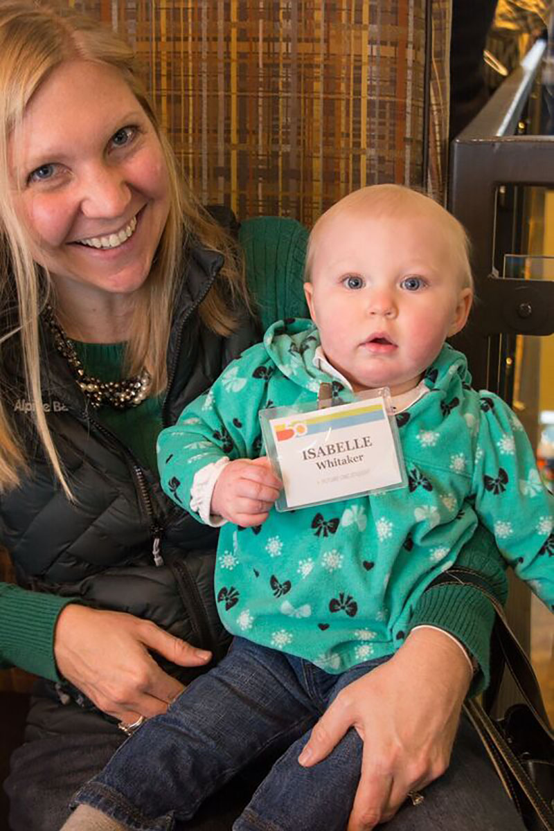 Lily Lewis, an employee of the Steamboat Springs Alpine Bank, which is a presenting sponsor of CMC's 50th celebration, brought daughter Isabelle Whitaker to the party.