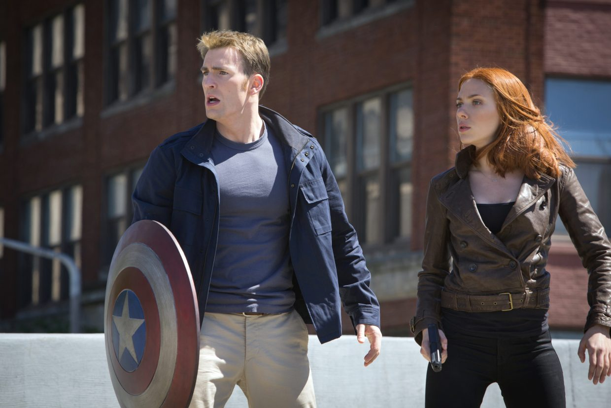 """Dressed in civilian clothes, Steve Rogers and Natasha Romanoff (Chris Evans, Scarlett Johansson), aka Captain America and Black Widow, seek to protect people from impending mayhem in """"Captain America: The Winter Soldier."""" The movie is a sequel in which the titular World War II superhero and member of the Avengers still is adjusting to the modern world."""