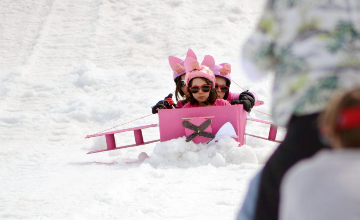 """""""When Pigs Fly"""" raced against """"To Infinity"""" in Saturday's 34th Annual Cardboard Classic at the Steamboat Ski Area."""