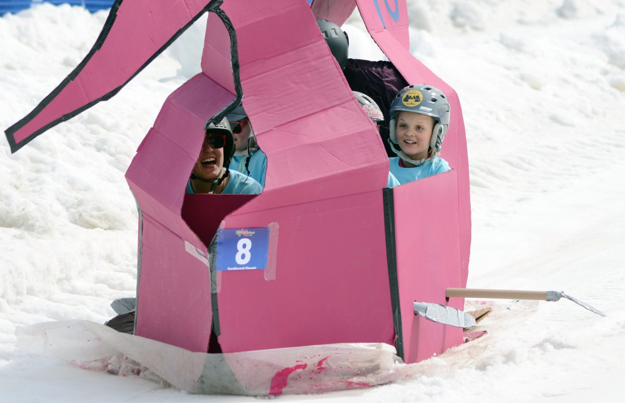 """They didn't sport green wigs or painted-orange faces, but that didn't stop the """"Willy Wonka and a Boatload of Oompa Loompas"""" car from storming down Stampede at the 34th Annual Cardboard Classic on Saturday."""