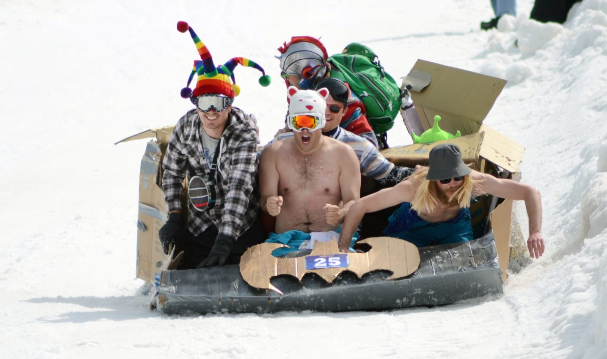 """Members aboard the """"Super Sleds"""" Batmobile struggled to keep off the Stampede embankment at the 34th Annual Cardboard Classic on Saturday."""