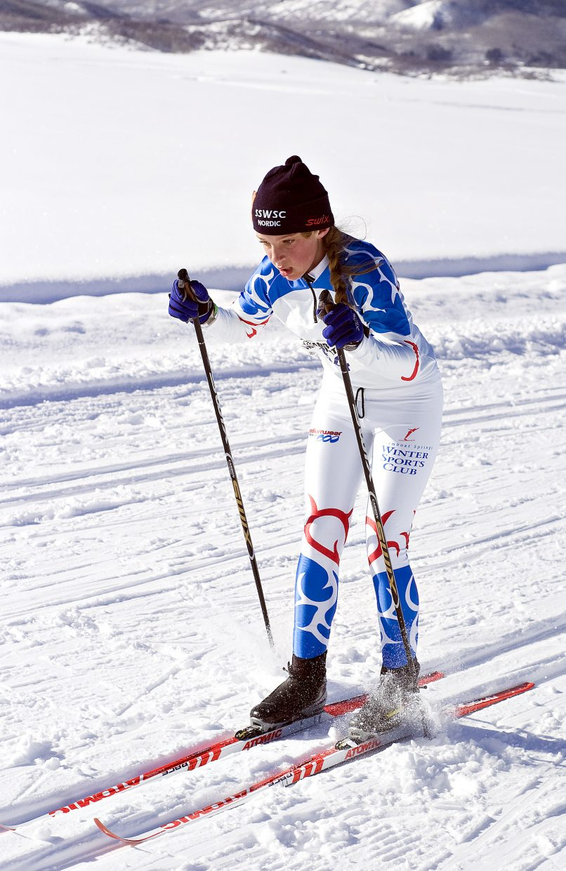Dori McNeill, 12, crosses the finish line of a classic skiing race at the Lake Catamount Touring Center outside Steamboat Springs on Saturday morning.