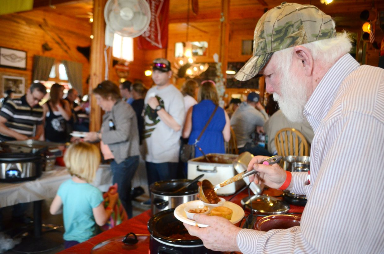 As usual, the Annual North Routt Chili Cook Off drew an enormous crowd. Last year's event was met with a cold snowstorm, but the 2015 Cook Off presented blue skies for a packed patio.