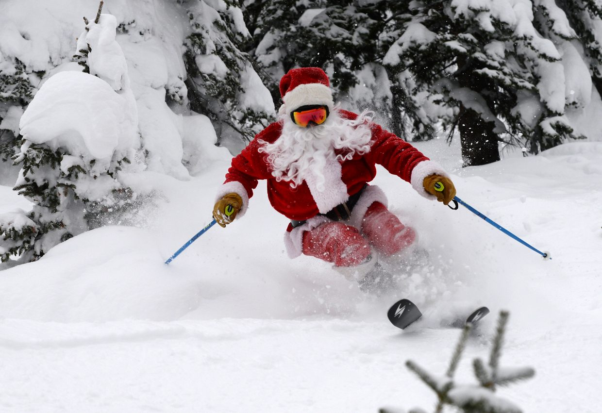 Santa Claus, who will take centerstage at Sunday's Holiday Festival, rips it up on Cyclone at Steamboat Ski Area.