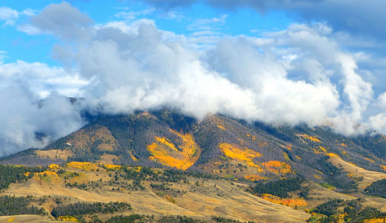 On the drive home from Boulder to Steamboat: clouds hovering over the mountain where the leaves are changing colors. Submitted by: Shannon Lukens