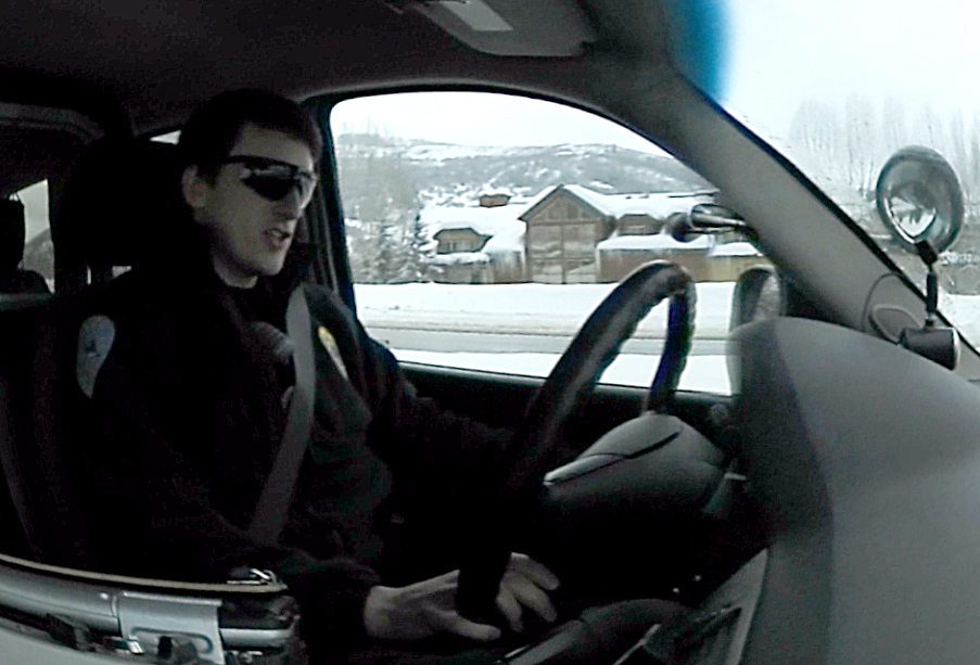 Steamboat Springs Police Officer Cody Owens drives a patrol cruiser on Lincoln Avenue.