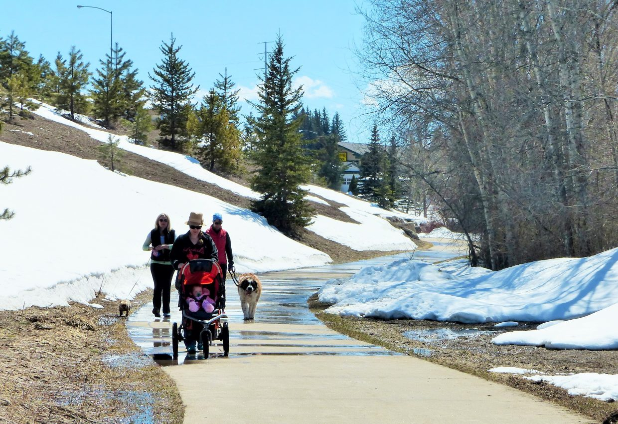 A few folks on a stroll down the Core Trail. (Three moms, a baby, and two dogs) You can see the snow melting. Submitted by Shannon Lukens.