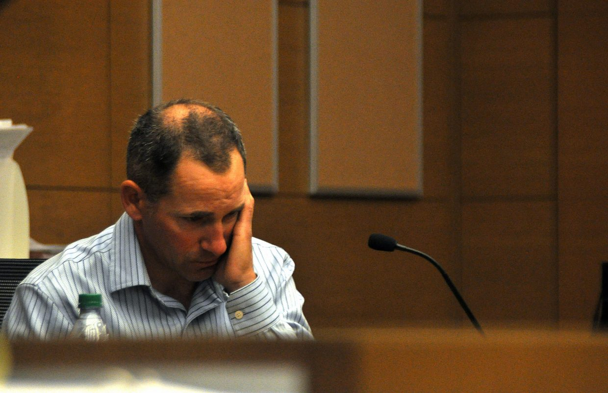 Michael Kirlan grows emotional Wednesday as he listens to a recording of the 911 call he made after he discovered his son, Asher, had died. His wife, Lisa Lesyshen, is accused of killing Asher.