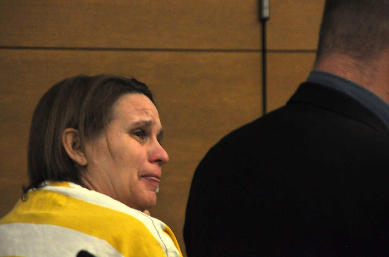 Lisa Lesyshen, accused of murdering her 9-year-old son, Asher, cries Wednesday during a preliminary hearing in Denver. A judge denied Lesyshen bond and concluded there was probable cause to put her on trial for first-degree murder.