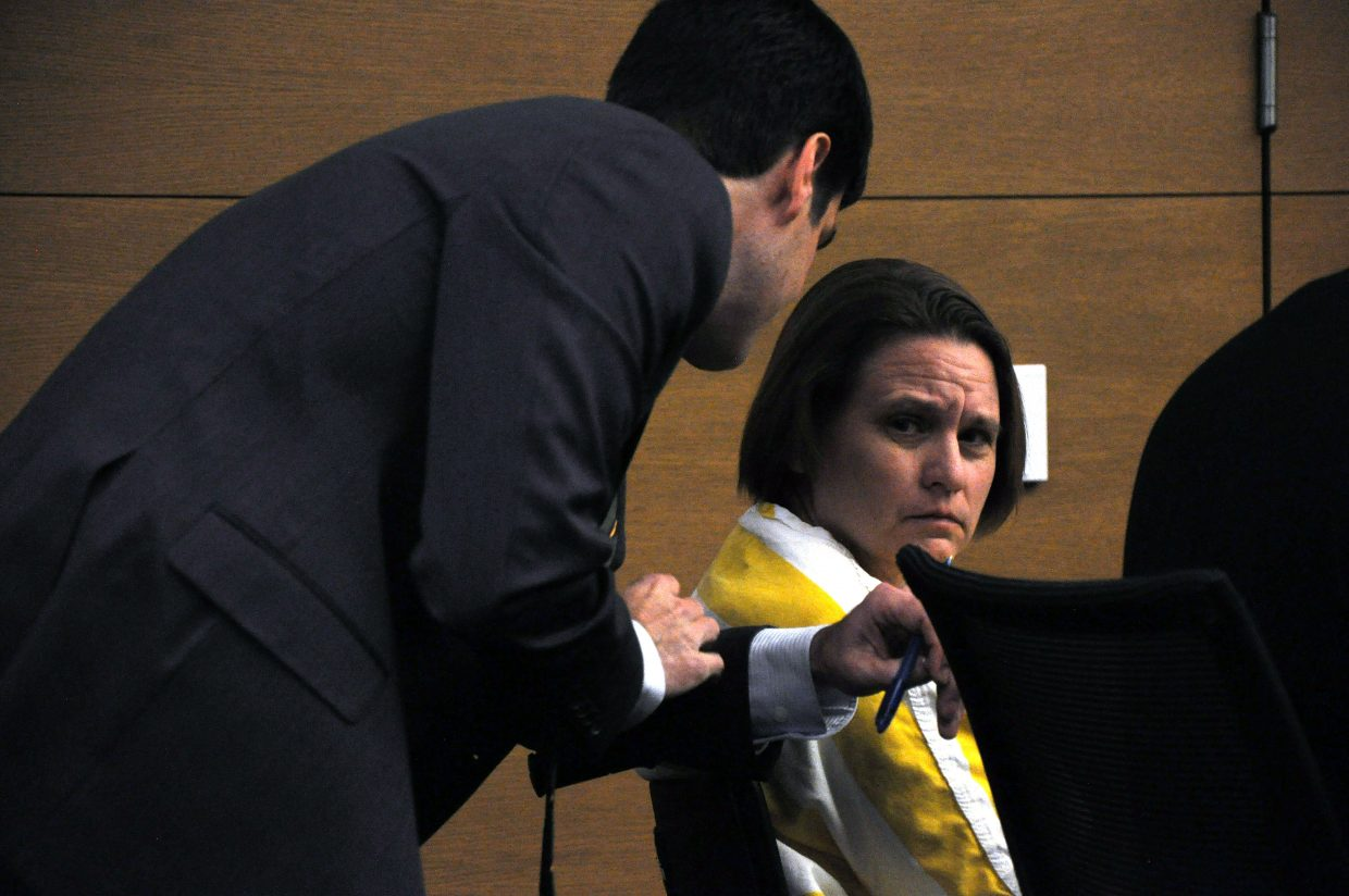 Lisa Lesyshen talks with public defender Scott Troxell at her preliminary hearing Wednesday in Denver. A judge denied Lesyshen bond and concluded there was probable cause to put her on trial for first-degree murder.