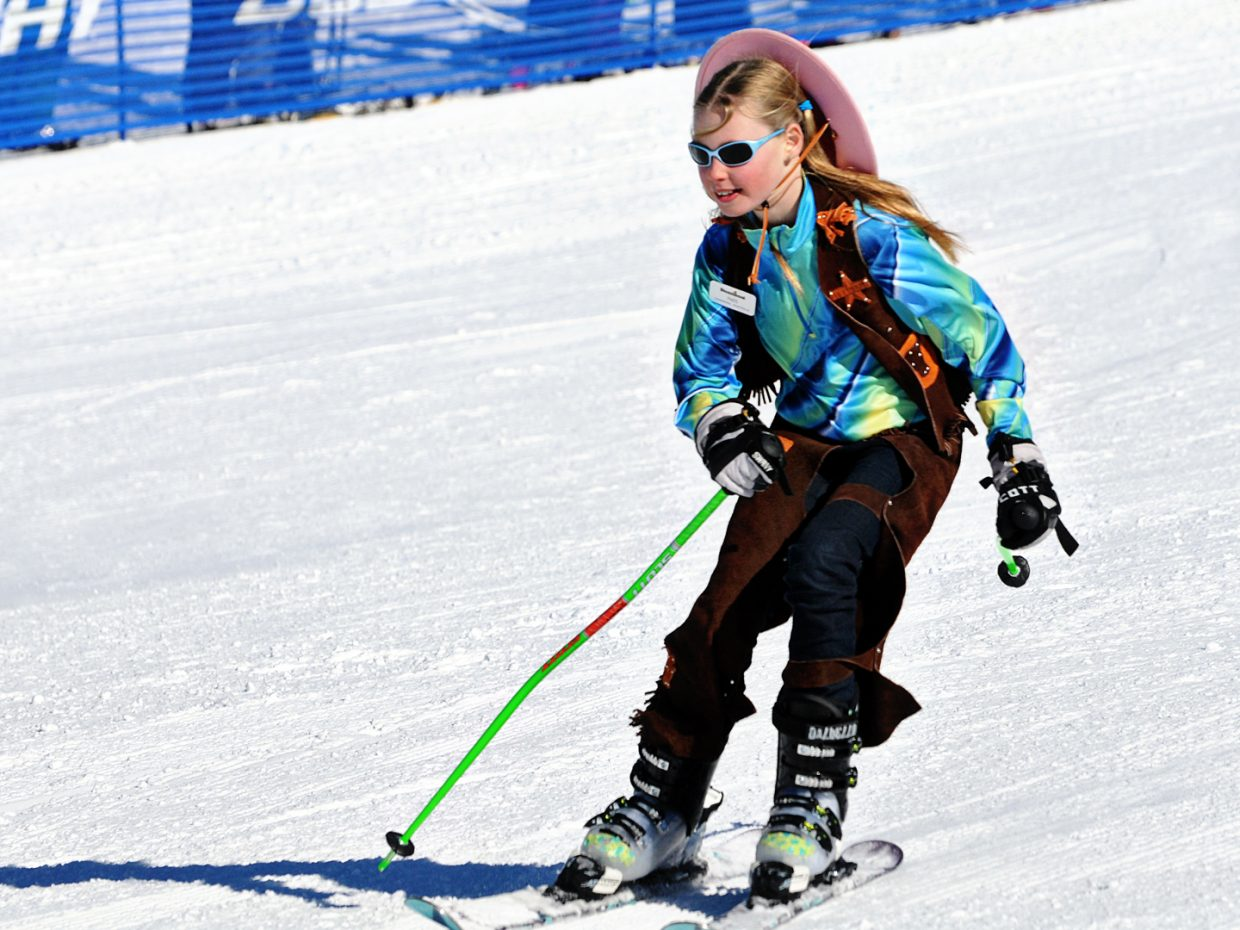 A young girl takes the course at the Cowboy Downhill. Submitted by: Jeff Hall