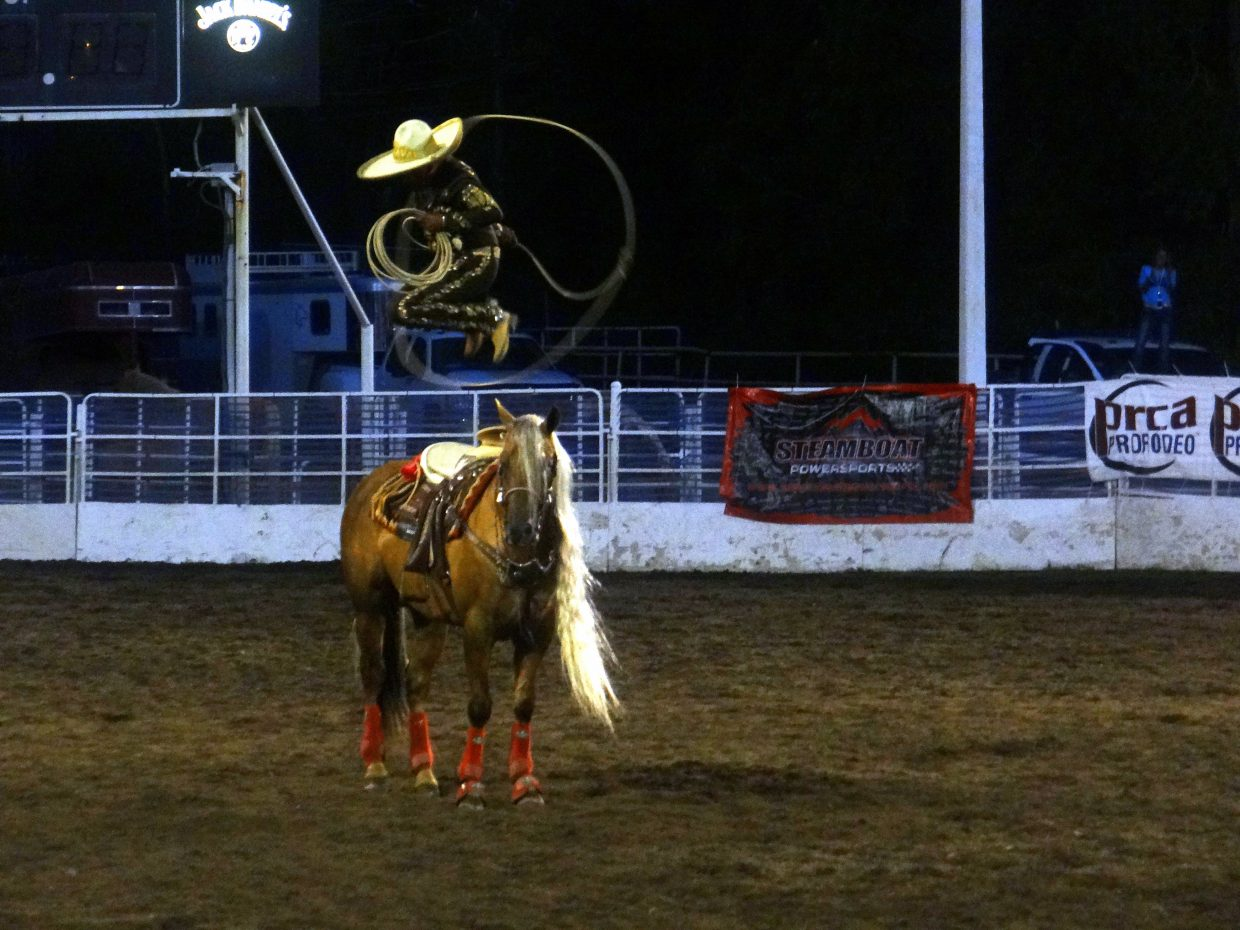 This was by far my favorite entertainment this last weekend at the rodeo. This roper is from Mexico and is amazing! Here is a shot of him jumping through his lasso loop while he was standing on this beautiful long maned horse. He is here for next weekend's rodeo also. Submitted by: Ann Hogan
