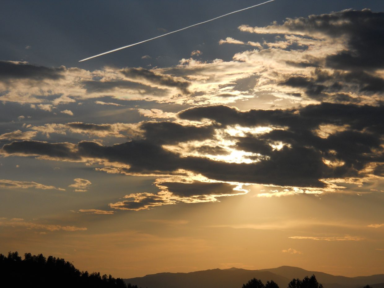 Such different sunset opportunities last night! I chose this one since it also the long contrail sets off the sunset! Have a blessed day! Submitted by Roxie Pranger.