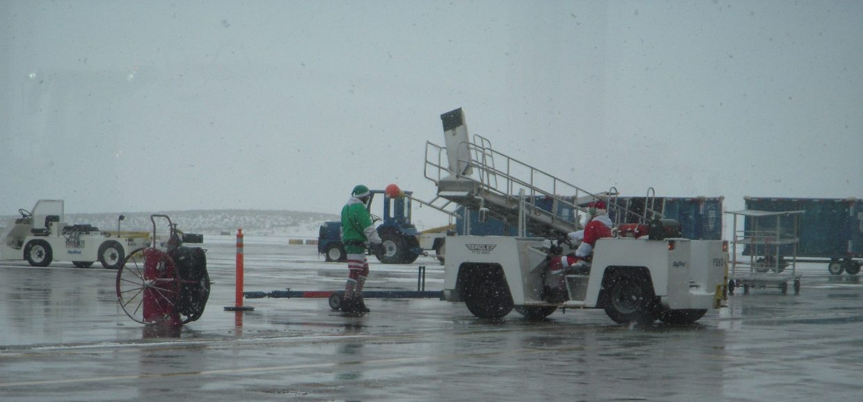 The ground crew guiding the Denver flight into their gate. Submitted by: Cindy Patten