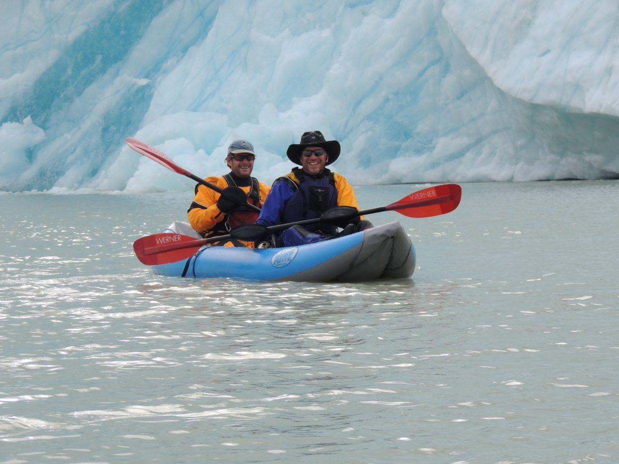 Eugene Buchanan and friend John Rouches flirt with the glacier's face after paddling over from Camp 3, careful to avoid potential boat-capsizing waves caused from glacial calving.