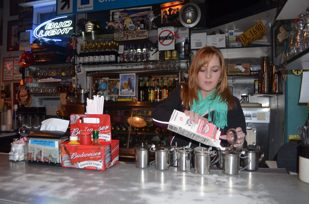 Shealynne Yeager fills the cream pitchers at Johnny B. Good's diner in time for the first regular of the morning to grab a cup of java.