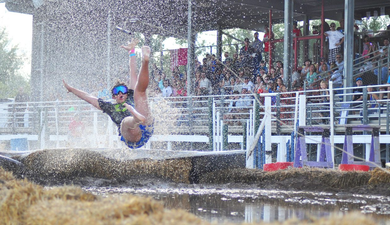 The crowd watches as a mudsurfer catches air at the 2014 Routt County RedneX Games in Hayden, Colorado. Submitted by: Wendy Lind