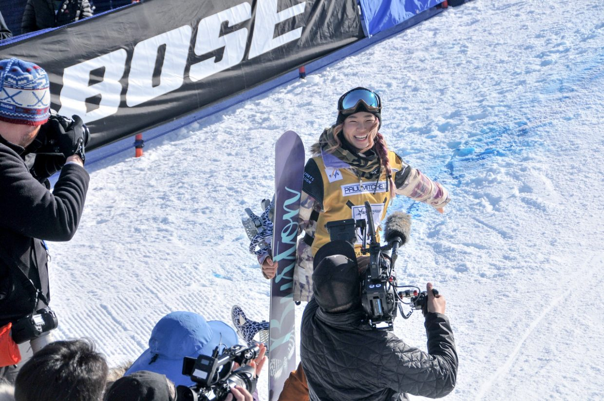 Rising snowboarding star Chloe Kim is all smiles after scoring a perfect 100 and winning gold at last weekend's X Games.