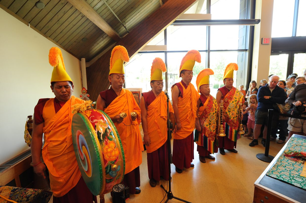 Drepung Loseling monks perform an opening ceremony for the sand mandala painting they will construct at Bud Werner Memorial Library
