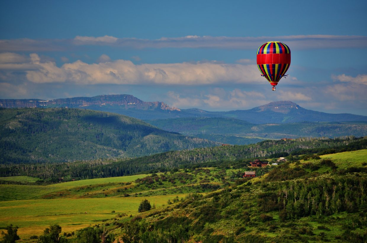 Flying High and Fancy Free over the beautiful Yampa Valley with the Flat Tops Wilderness Area in the distance. Submitted by: Rebecca Musso