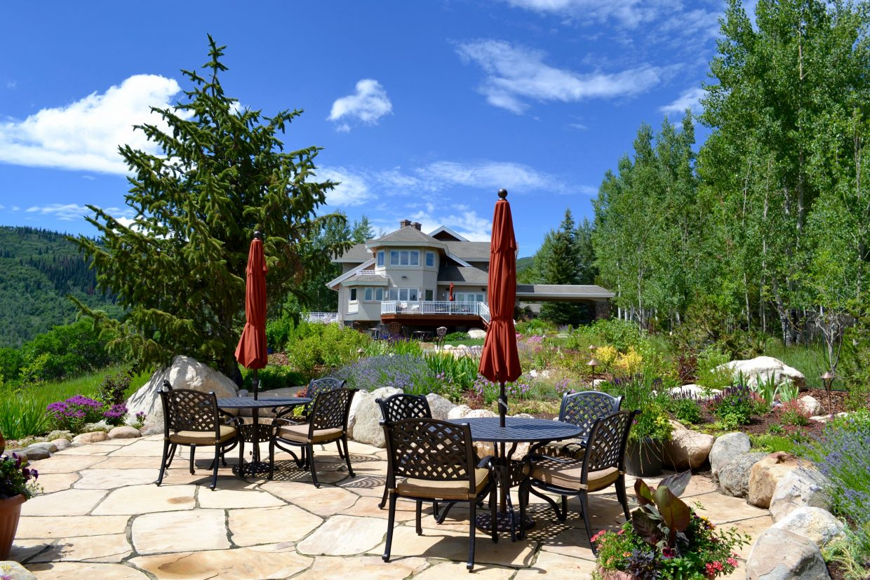 One featured home in Dakota Ridge on the Strings Kitchen and Garden Tour offers spectacular views from a lower seating area.