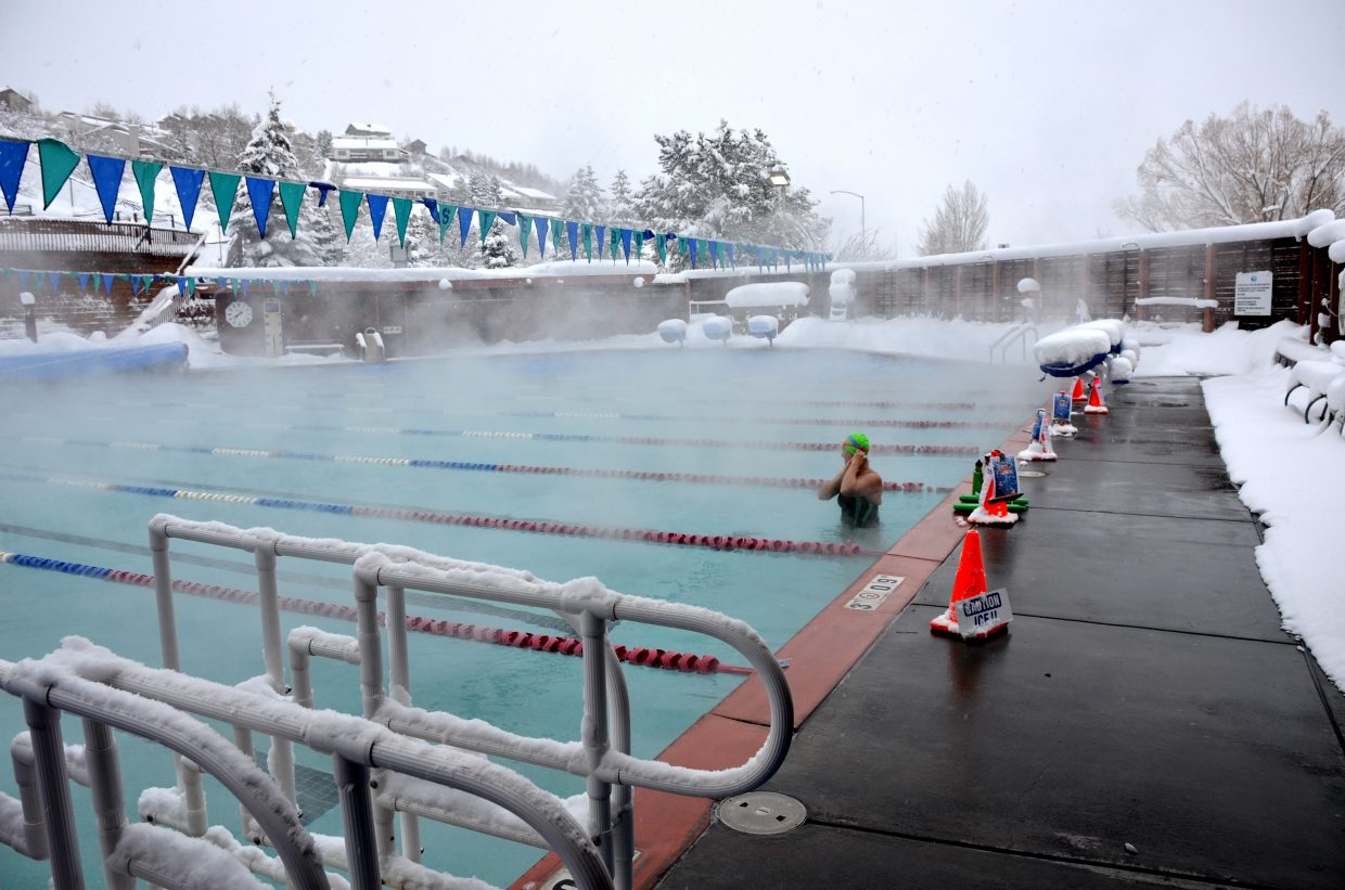 Jill Ruppel hopped into the lap pool for a few laps Monday morning, despite more than 14 inches of new snow in the past 24 hours. Submitted by: Shannon Lukens