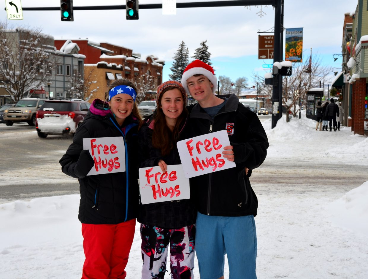 Three freshman members of the Steamboat Springs High School Class of 2017 were among a happy group downtown Tuesday, giving Free Hugs. Pictured left to right: Sierra Good, Caitlin Musselman, Colin Musselman. Submitted by: Shannon Lukens
