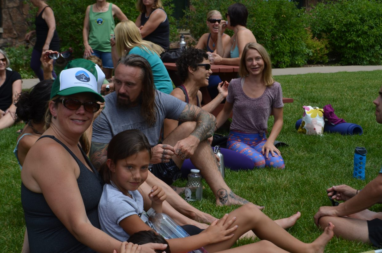 Kristen Rockford and her kids smile for a photo among friends in between yoga classes at the Steamboat Movement Fest over the weekend.