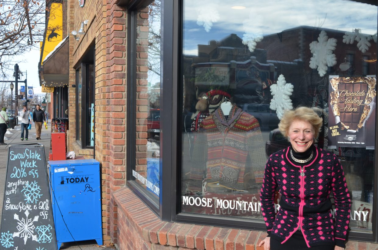 Jenny Wall stands outside her shop, Moose Mountain Trading Co., by the window full of snowflakes, similar to the chocolate they will have available for the Chocolate Tasting event Saturday. The event is meant to support Small Business Saturday.