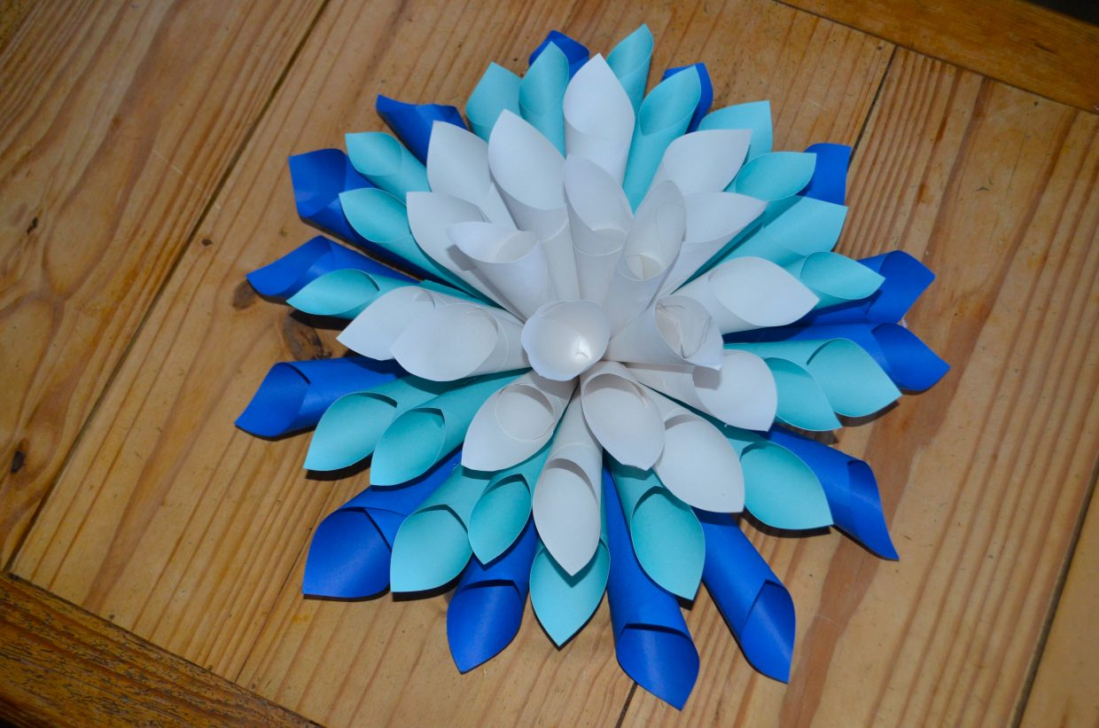 Inspired by a friend's paper art instillation, arts and entertainment reporter Audrey Dwyer, went out of her comfort zone to make a new holiday gift, a Paper Dahlia Snowflake.