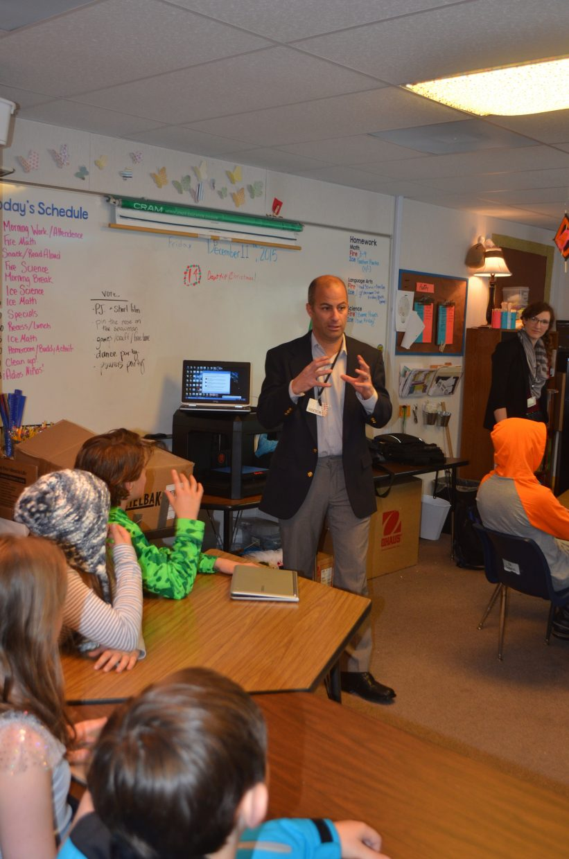 CMC engineering professor Steve Craig explains a few techniques of the 3D printing process to a group of fifth graders at Soda Creek Elementary School on Friday.