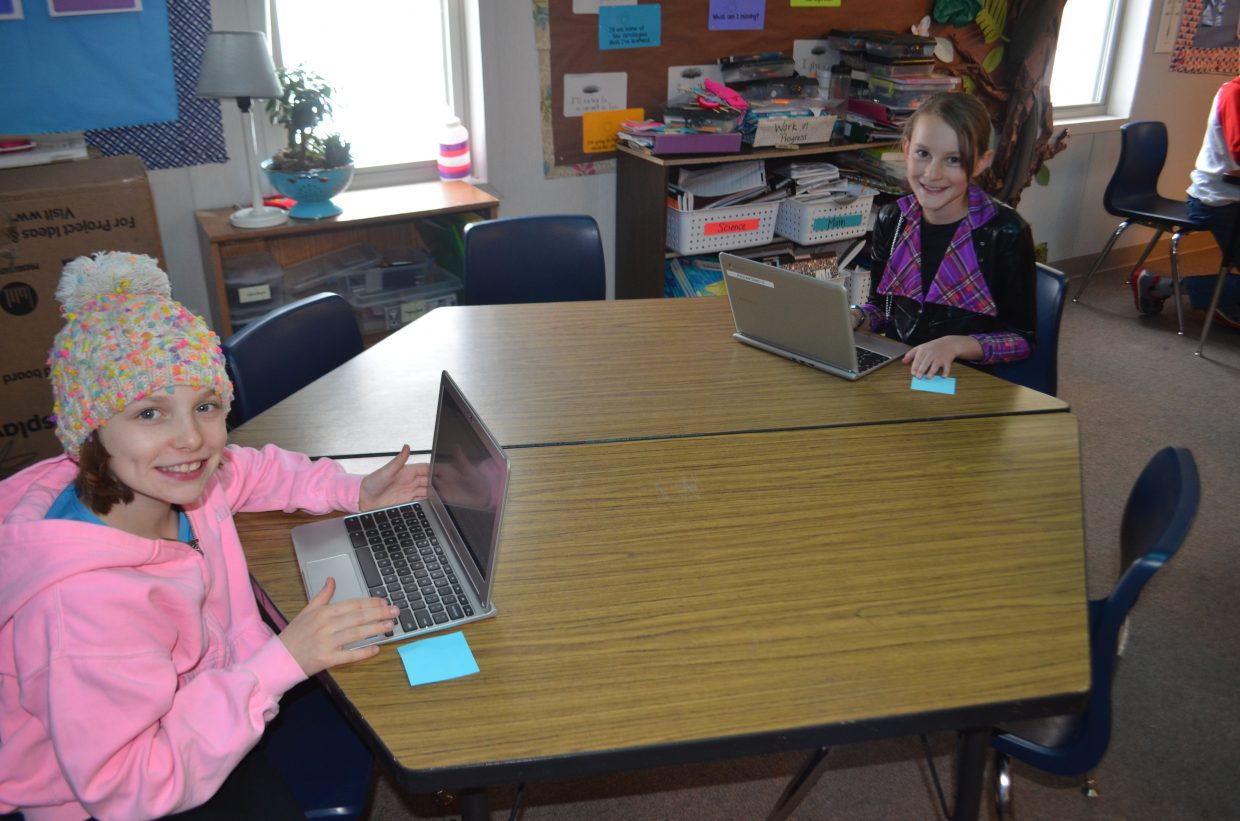 In this photo Meaghan Maitre and Taylor Graham work on their Chrome Books creating designs that will become 3D objects.