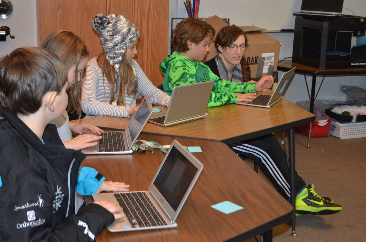 In this photo Charlie Thompson, Lucy Travis, Caroline Landers, Cade Gedeon and Tia Valles work on their Chrome Books creating designs on TinkerCad that will be turned into 3D objects.