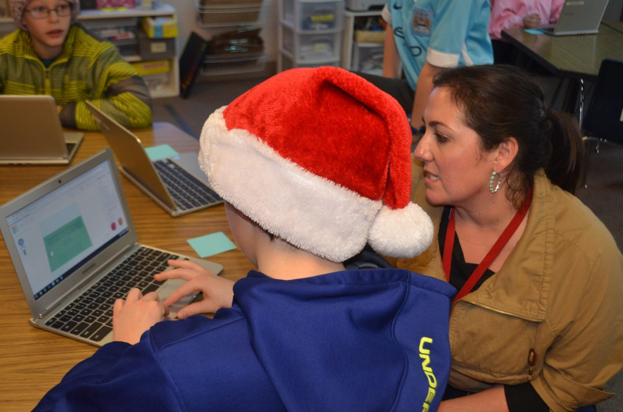 Strawberry Park Elementary School fifth-grade teacher Kyle Paolantonio helps one of her students work with the TinkerCad program that designs 3D objects.
