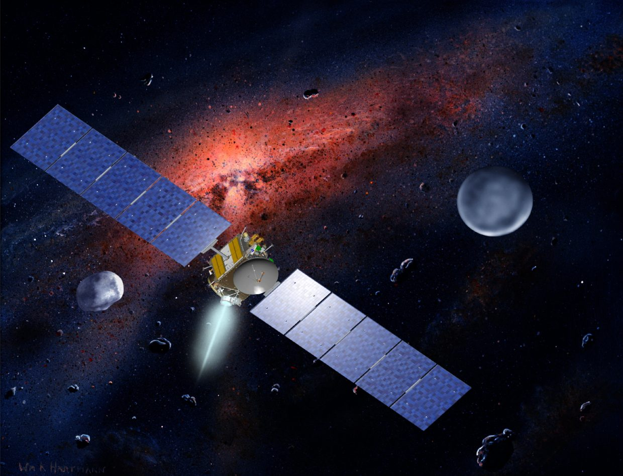 In this artist's conception, NASA's Dawn spacecraft is shown with its two primary targets, asteroid Vesta and asteroid/dwarf planet Ceres. Dawn already has spent a year orbiting and mapping the surface of Vesta and now is on its way to rendezvous and orbit the Texas-sized dwarf planet Ceres in March. Astronomers theorize that Earth and the other large planets were formed from the assimilation of mini-worlds like Vesta and Ceres. Studying them could tell us about Earth's early history.