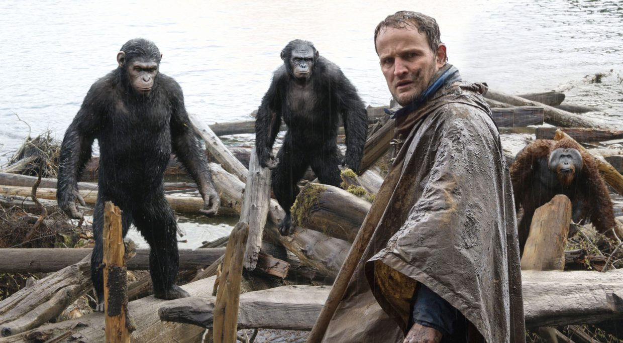 """Human Malcolm (Jason Clarke) has a tense meeting with primate leader Caesar (Andy Serkis) in """"Dawn of the Planet of the Apes."""" The movie is a sequel to the 2011 reboot of the 1960s and '70s series about highly intelligent apes."""