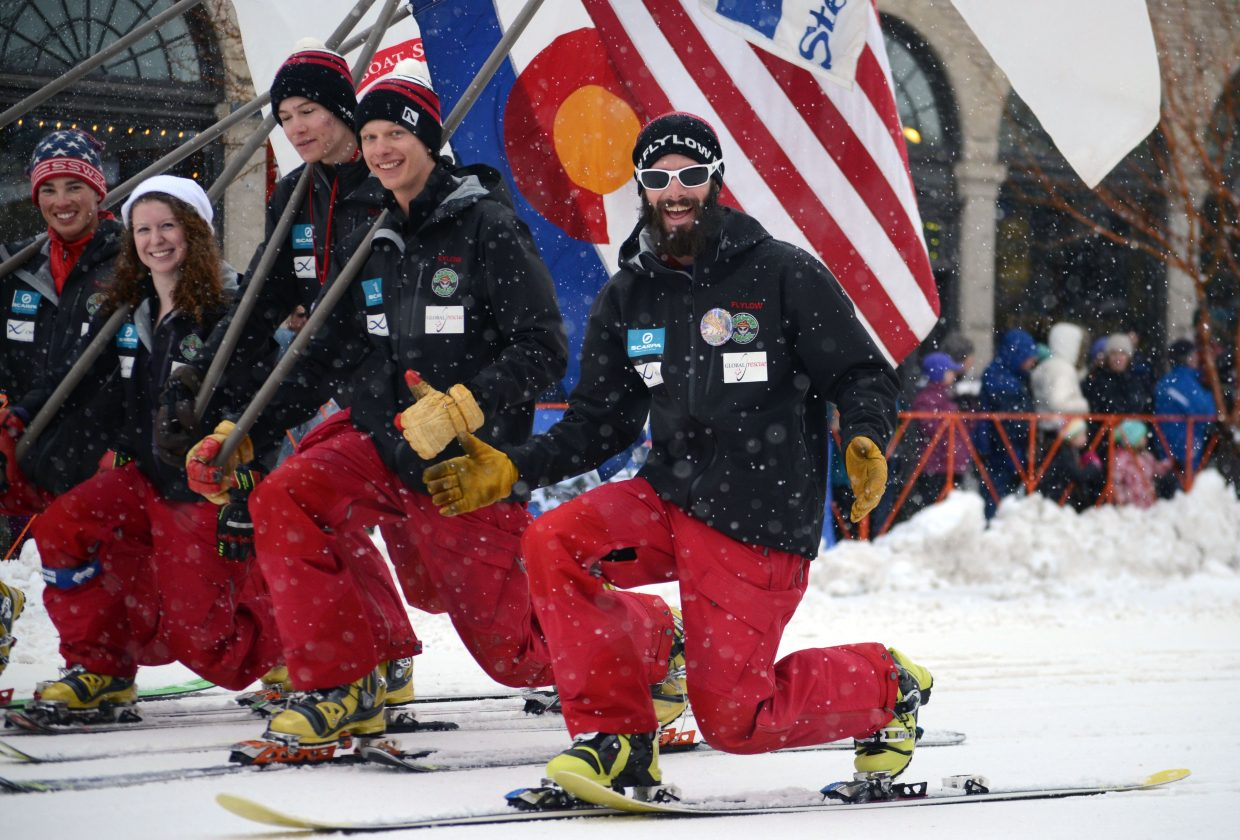 Members of the U.S. Telemark National Team made their way down Lincoln Avenue during the 101st Winter Carnival's Diamond Hitch Parade on Sunday.