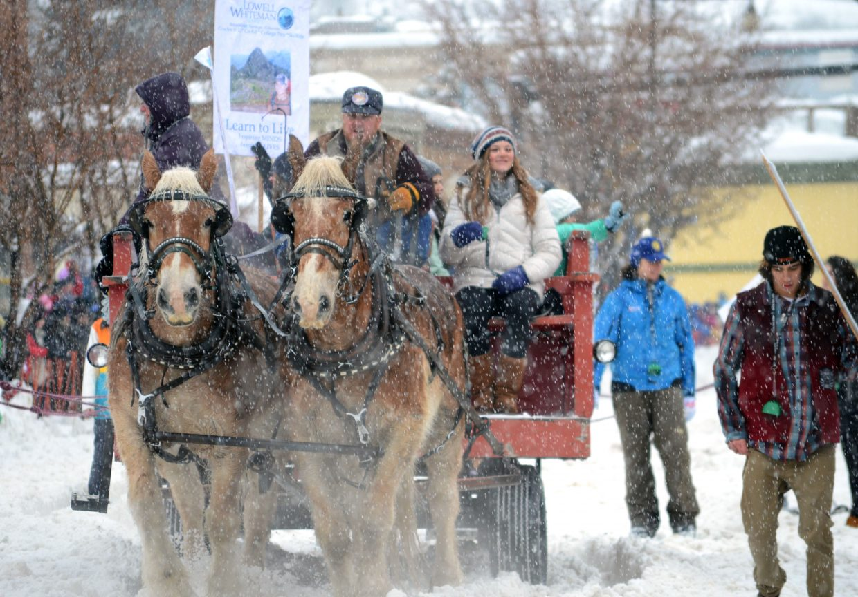 The Lowell Whiteman School's Diamond Hitch Parade float — like many others Sunday — was escorted by two horses.