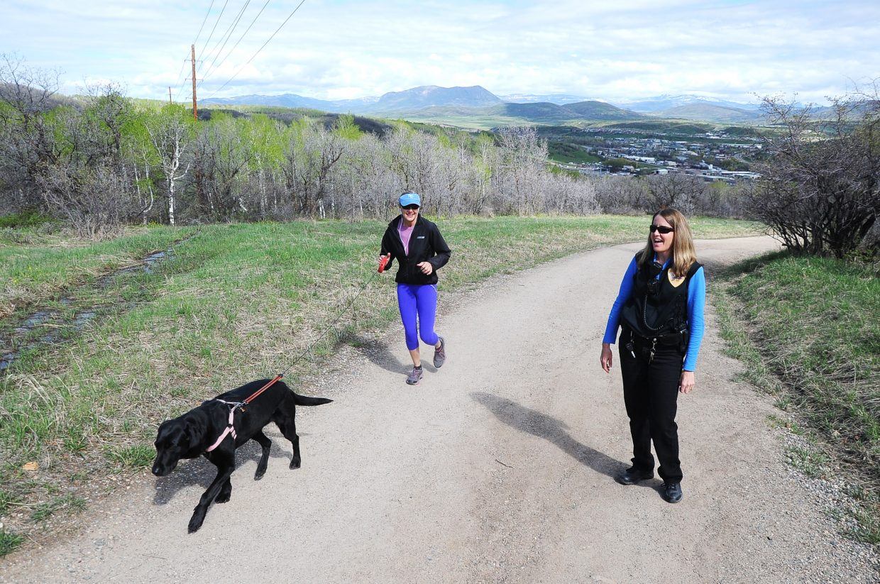 Steamboat Springs Animal Control Officer Jennifer Good thanks a dog walker for keeping her dog on a leash in May on Blackmere Road.
