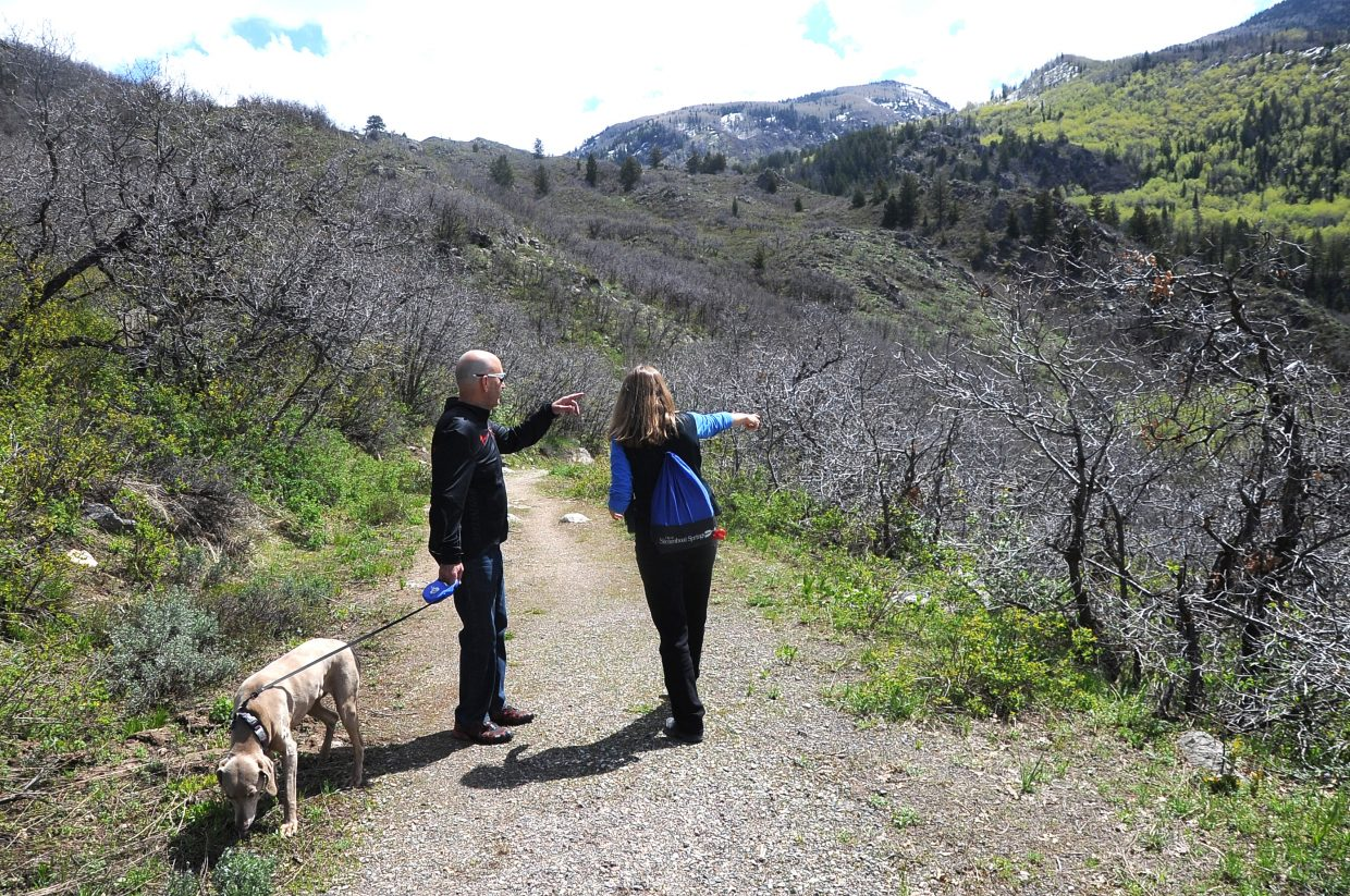 Animal Control Officer Jennifer Good tells dog-walker Larry Bookman where he can walk his dog off leash Wednesday on the Skyline Trail.
