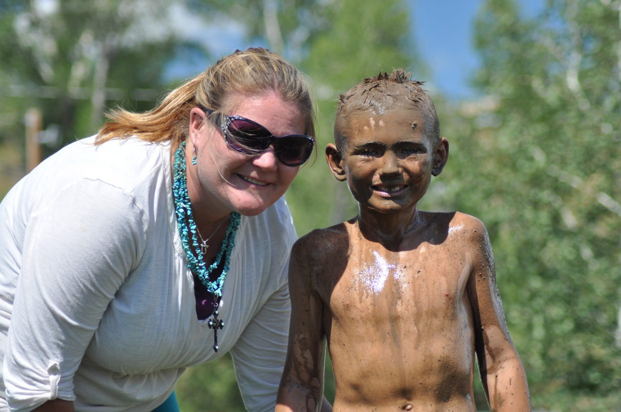 Tammie and her son Dorian after his mudsurfing run at the 2014 Routt County RedneX Games in Hayden, Colorado. Submitted by: Wendy Lind