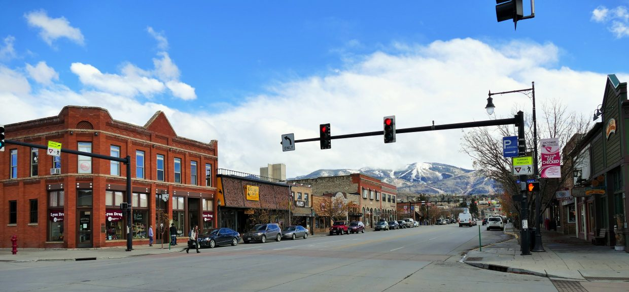 We woke up to snow, and then rain, and then it cleared up for the afternoon. Now we're waiting for the heavy snow to return tonight. I just snapped this pretty picture in downtown Steamboat Springs, on Lincoln Avenue.