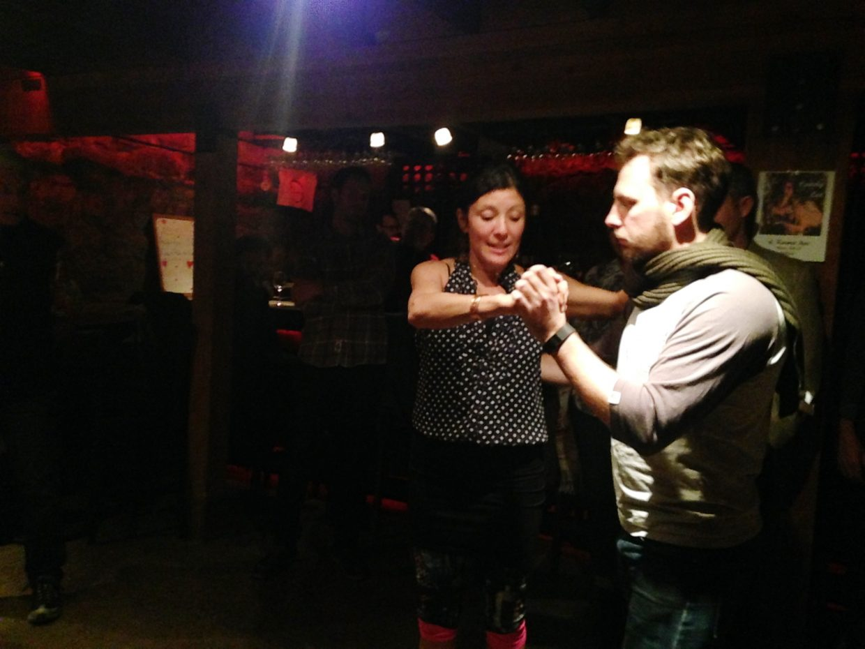 At the Karma Bar & Wine Lounge, salsa teacher, Eva Luna teaches Paul Roberts who is visiting from Australia. In this photo, Luna was teaching Roberts how to properly guide a woman with pressure on her back through the tango.
