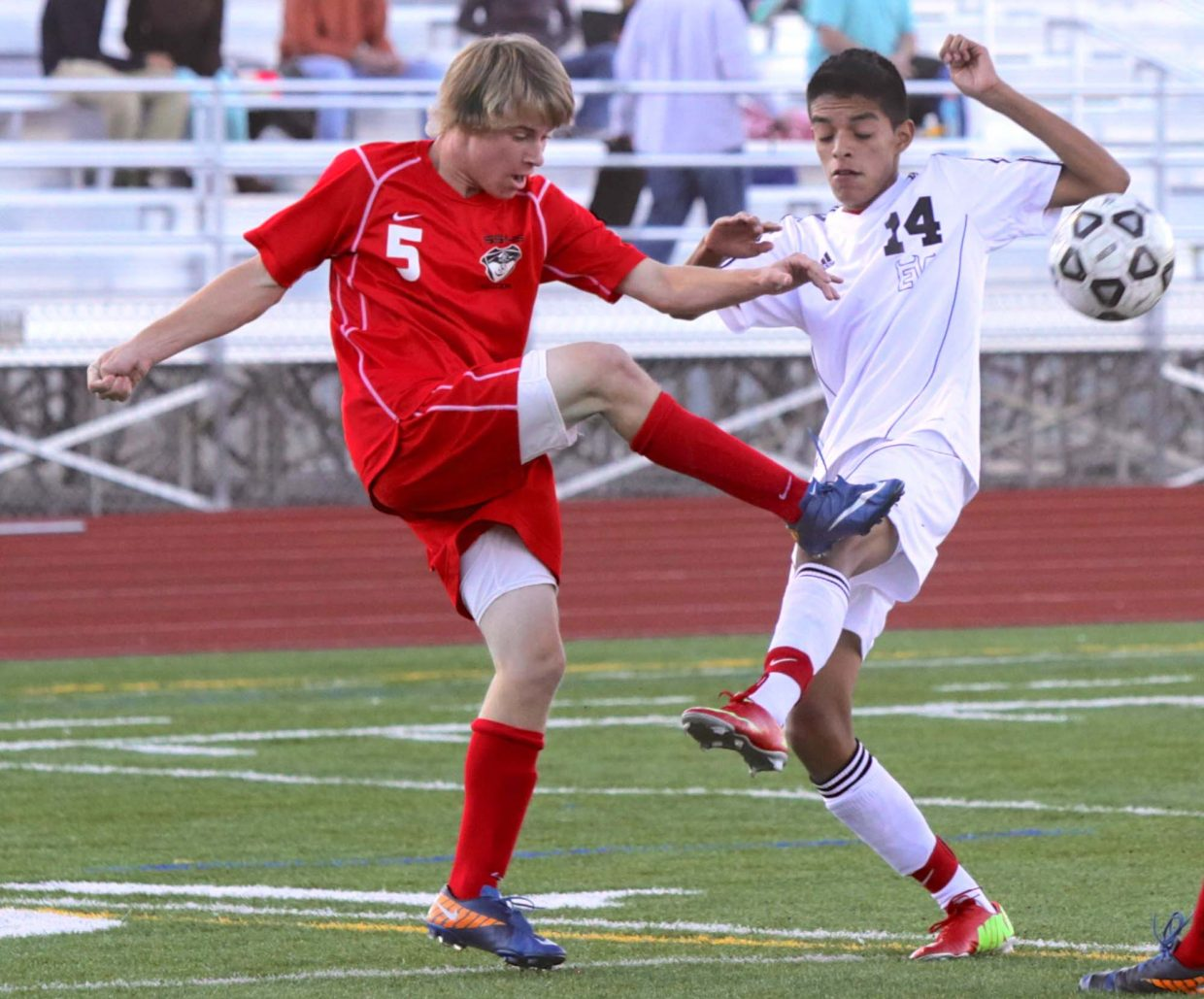 Steamboat's Will Petersen, left, kicks the ball away from an Eagle Valley player during their game Tuesday at Eagle Valley. The game ended in a 3-3 tie.
