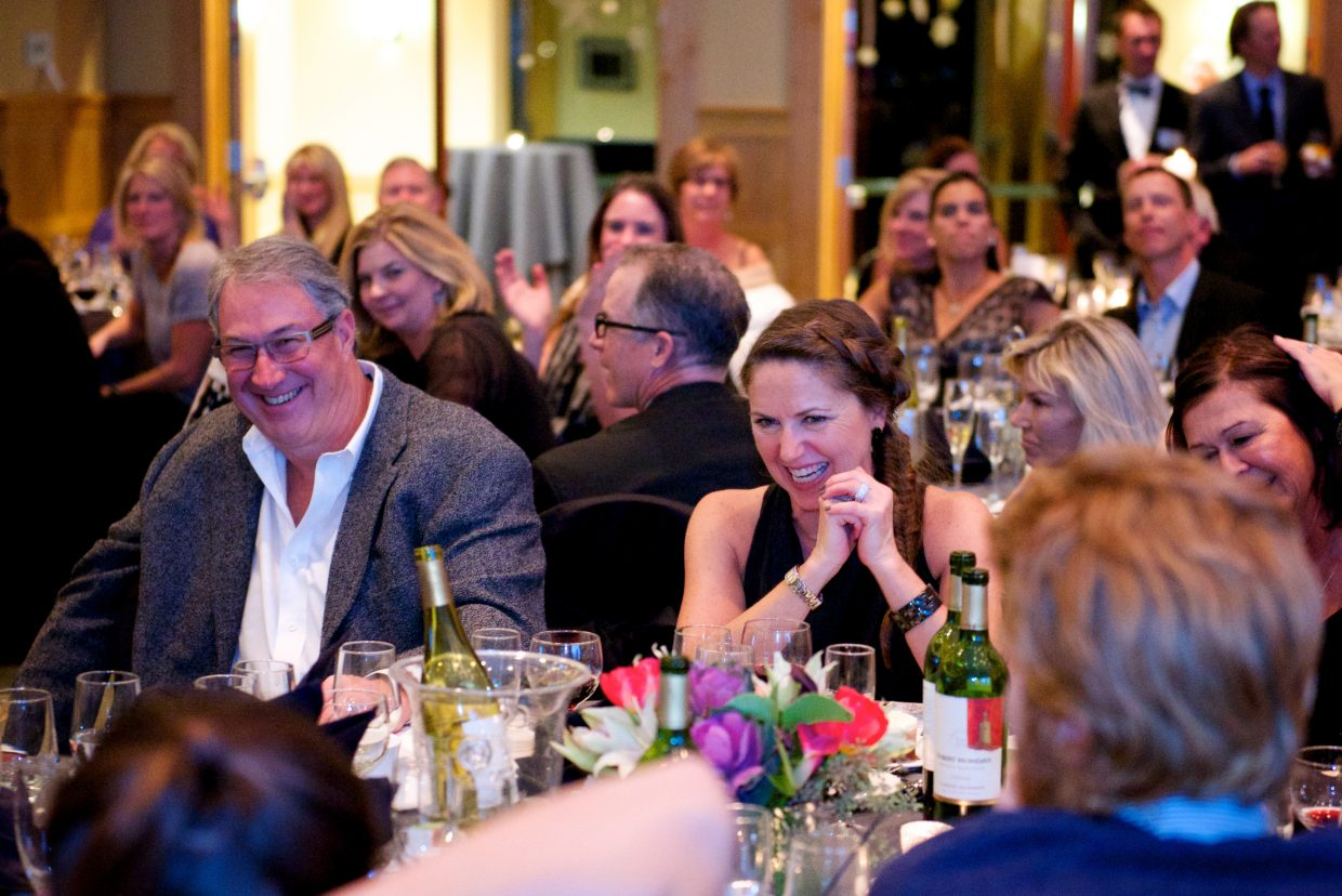 Guests enjoy the commentary during the live auction at the Stars at Night Gala fundraiser.