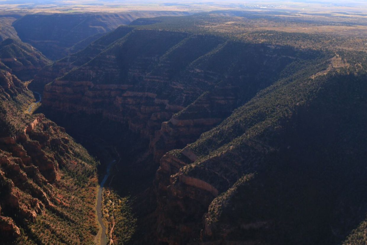 In this aerial photo, the river canyons hide the Dolores River from view and shows the landscape of canyon to where the river has gone and how low it is due to the dam.