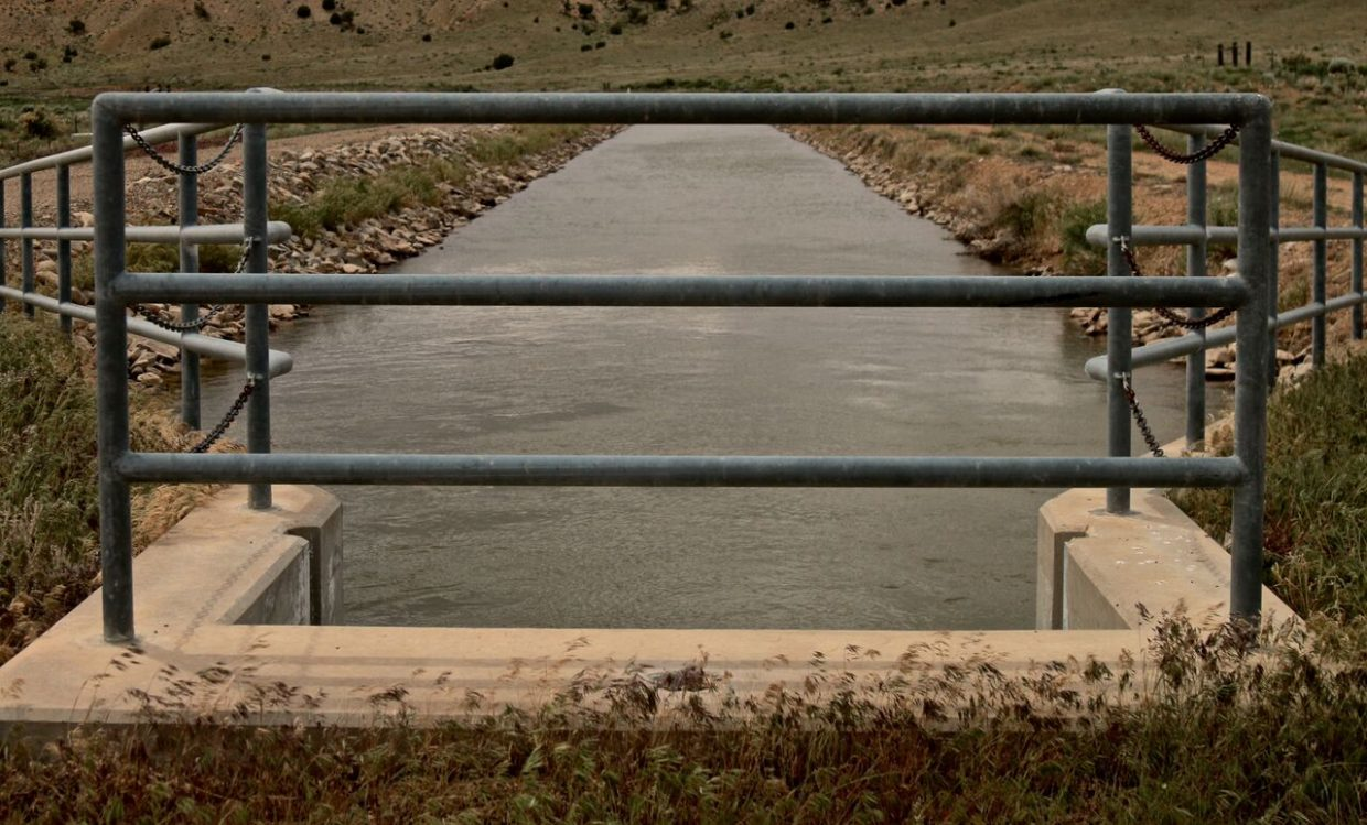 """Photographer Jules Poma from the Rig to Flip production team captured this image from their most recent film project of the Dolores River that represents a """"river behind bars,"""" due to the water being allocated for agricultural use with no recreational access to it."""